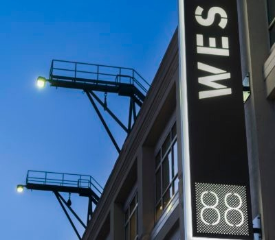 Exterior lit blade signage for 88 Black Falcon in Boston Massachusetts