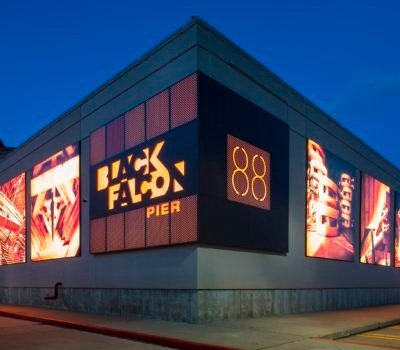 Exterior lit parking structure signage for 88 Black Falcon in Boston Massachusetts
