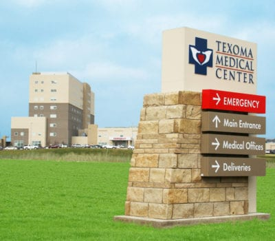 Exterior directional sign for UHS Texoma Medical Center in Denison Texas