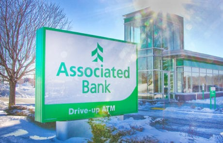 Exterior face lit sign for Associated Bank in downtown Milwaukee Wisconsin