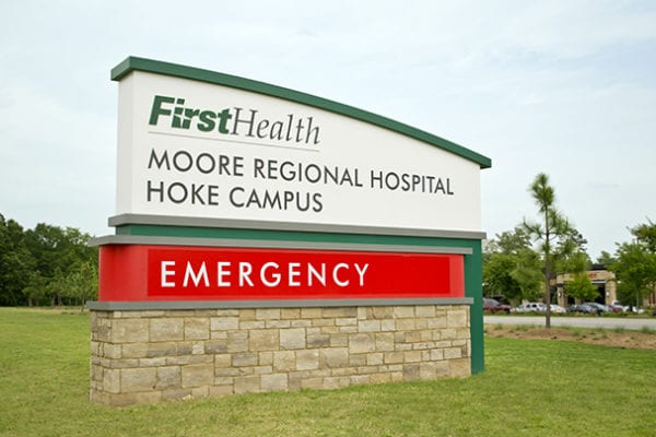 Exterior lit monument sign for FirstHealth Moore Regional Hospital in Hoke County North Carolina