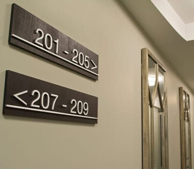 Interior directional signs for Skyhouse Raleigh in Raleigh North Carolina