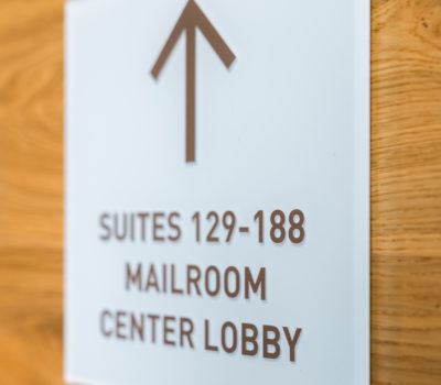 Interior directional signage for 88 Black Falcon in Boston Massachusetts