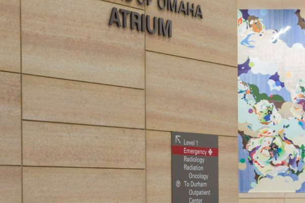Interior dimensional letters and directional sign at Nebraska Medicine Fred & Pamela Buffett Cancer Center