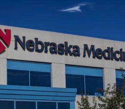 Exterior lit channel letters and logo signage for University of Nebraska Medicine