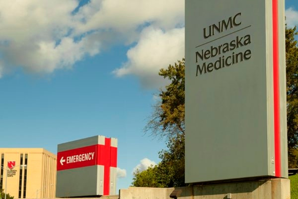 Exterior lit monument and logo signage for University of Nebraska Medicine