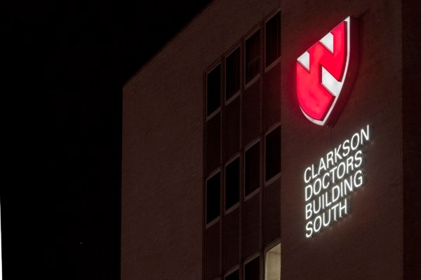 Exterior lit channel letters and logo signage for University of Nebraska Medicine