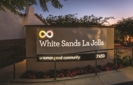 Exterior lit sign for White Sands in La Jolla California