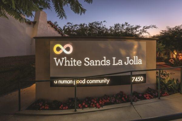 Exterior lit sign for White Sands in La Jolla California